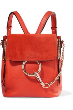 Tomato-red leather and suede (Calf) Snap-fastening front flap Designer color: Sepia Red Weighs approximately 2.2lbs/ 1kg Comes with dust bag Made in Italy