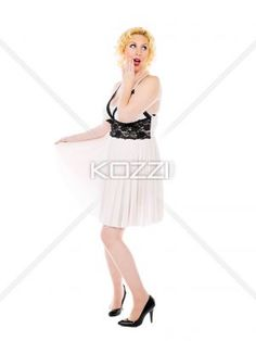 woman with secret to tell - Woman holding hand to her mouth, gesturing a whisper, on white. MUA and Model: Amanda Wynne