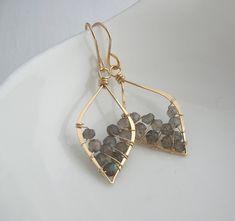 Hand-forged leaf hoops encircle an array of stunning Labradorite gemstones.    Earrings hang 3cm below Ear.    Available in Sterling Silver