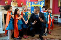 President Obama views science exhibits during the 2015 White House Science Fair celebrating student winners of a broad range of science, technology, engineering, and math (STEM) competitions, in the Red Room, March 23, 2015. The President talks six-year-old Girl Scouts, from Tulsa, Oklahoma that used Lego pieces and designed a battery-powered page turner to help people who are paralyzed or have arthritis. (Official White House Photo by Chuck Kennedy)