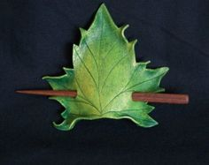 The Sycamore leaf is hand scribed and sculpted from 4oz vegetable tanned leather…