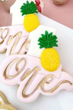 Take a look at the sweet pineapple 'one' cookies at this tropical flamingo 1st birthday party See more party ideas and share yours at CatchMyParty.com #catchmyparty #partyideas #4favoritepartiesoftheweek #unicorns #pineapplecookies #flamingoparty #girl1stbirthdayparty