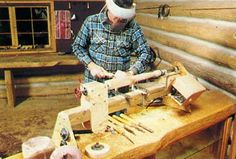"""Wood Lathe by Mother Earth News -- Homemade wood lathe constructed from pressure-treated 4x4s, 3/4"""" plywood, a washing machine motor, bearings, mandrels, shafting, and pulleys. http://www.homemadetools.net/homemade-wood-lathe-14"""
