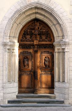 elaborately carved wooden door - tallinn, estonia