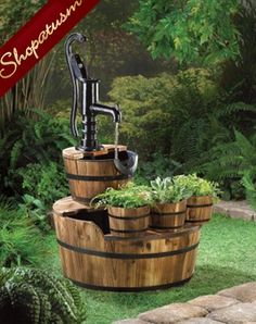 Vintage-inspired well pump fountain Water falls from the well pump into wooden barrel 3 Front mounted wooden bucket planters Black iron banding Each bucket: x x deep Large water bucket: x x deep Pump Included Iron Fir Wood x x Barrel Fountain, Patio Fountain, Garden Fountains, Outdoor Fountains, Fountain Ideas, Water Fountains, Flower Planters, Garden Planters, Flowers Garden