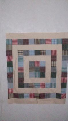 A baby quilt made with men's upcycled dress shirts.
