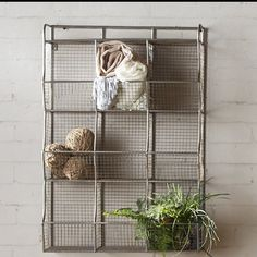 "null This wire mesh cubical storage is perfect for hanging in your living room, entryway, office, craft space and more. Nine baskets are available for storing decorative accents, extra candles, balls of yarn, and other crafting supplies, scarves, plants, and so much more. This storage piece is crafted of metal with a gray finish, and includes shelf brackets for hanging. It measures 33.5'' H x 23'' W x 10'' D, which each cubby measures 6.4"" H x 8"" W x 9.9"" D."