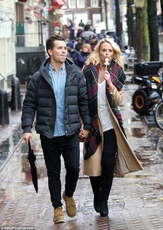 Chilly willy: Rhian Sugden, 30, showed off her naughty side recently as she enjoyed a romantic stroll through Amsterdam's red light district with fiancé Oliver Mellor, 35