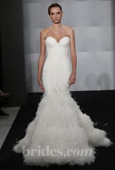 Brides.com: Mark Zunino for Kleinfeld - 2013. Style MZBF63, strapless beaded mermaid wedding dress with a sweetheart neckline and feather skirt, Mark Zunino for Kleinfeld  See more wedding dresses in our gallery.
