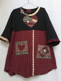 Upcycled Black Sweatshirt Dress with Plaid Button front, appliqué Patchwork Pockets , Rustic Country Artsy Patchwork Heart , redesigned neckline and sleeves to fit loose with no pull when you move! Fits medium to XL 21 across armpit to armpit 33-34 long Free hips and waist Fit is oversized and loose