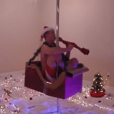 Pin for Later: This Clarinet-Playing Pole Dancer Is the Only Christmas Gift You Need