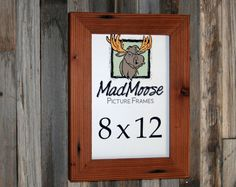 """This MadMoose Picture Frame is sized to fit a 8x12 photo, print or  mounted canvas up to 1 thick ~the boards are reclaimed redwood which has been milled to approximately 2 wide and about 1¼"""" thick ~the wood will show off signs of previous use such as nail holes, insect tracks, staining & etc. ~t"""