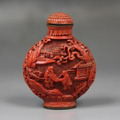 A Chinese Carved Cinnabar Lacquer Snuff Bottle