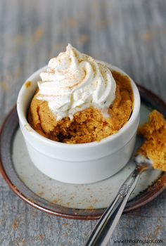 Easy Pumpkin Mug Cake by thegunnysack: 60 seconds to warm, delicious cake! Make it with 3 TB cake mix, 1TB pumpkin puree, 1TB water and 1/2 tsp pumpkin pie spice.