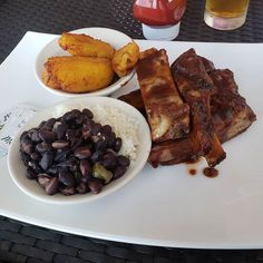 Brunch time: Sweet and tangy bbq ribs with rice and beans and more sweet plantains plantains plantains! Told you I was gonna eat a lot of them plantains! LOL at at before going on the boat tour in Magic City, Bbq Ribs, Boat Tours, Sunshine State, Miami, Beans, Brunch, Wanderlust