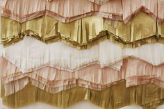Layered tissue fringe in the theme colors. Would be cool for some kind of backdrop.. Maybe for a dessert table?