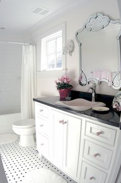 Wouldn't it be lovely to have this fancy mirror in our bathroom instead of our tacky-looking medicine cabinet?