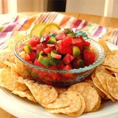 "Watermelon Fire and Ice Salsa | ""Juicy watermelon replaces tomatoes in this salsa that's simultaneously cool and spicy hot -- perfect for a summer barbeque. Serve it with tortilla chips, or use it as a topping for grilled chicken or fish."""