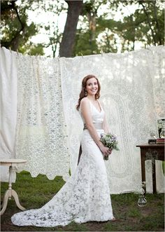 For an outdoors wedding maybe a lace screen or perhaps hessian screen.......