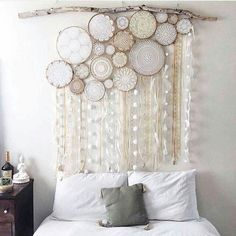 Cool idea for a headboard. Dreamcatchers with fun fabric ribbons. Hang from a stick.