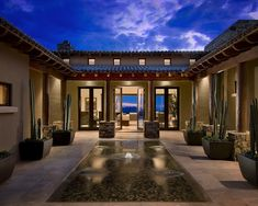 Mirroring the sky and the earth, reflecting pools and ponds heighten the sensory experience of nature in your landscape