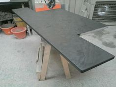 Smooth Honed T Shape slate hearth.  Honing can really bring out some beautiful natural patterns in the slate!