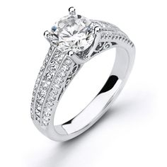 Runway Collection - This gorgeous 18K white engagement ring is comprised of .19ctw round white Diamonds and .45ctw princess cut white Diamonds.  - LP1219