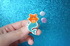 This purrmaid brooch is perfect to pin to your jacket, cardi or tote bag!  Created on adobe illustrator, taken to print onto shrink plastic, cut out, placed in the oven on high heat and finally sprayed with matt varnish to look how it does today! All of my items are sent via first class post. Please read my shipping policies carefully before purchase. The brooch is roughly 4cm tall and 2cm wide, however this may slightly differ due to the shrinking process. Please take care of your brooch…