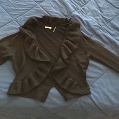 Neiman Marcus short frilly cardigan Long sleeved, fee runs in knit as shown, barely visible, 70%acrylic, 30% wool Neiman Marcus Sweaters Shrugs & Ponchos