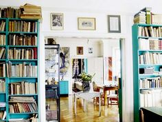 book shelves painted turquoise. love this.