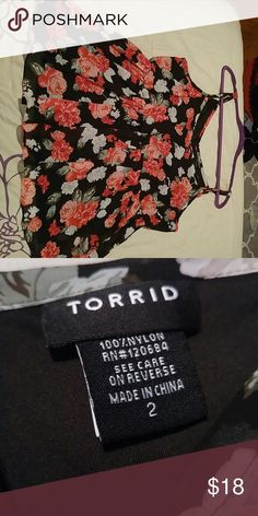 Torrid Babydoll top Torrid Sz 2 Babydoll top. Very flowy chiffon black and red floral print. Like new condition torrid Tops Blouses