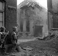 Men of the 1st Royal Norfolks, 3rd Division, clearing enemy resistance in Kervenheim, Germany, 3 March 1945.
