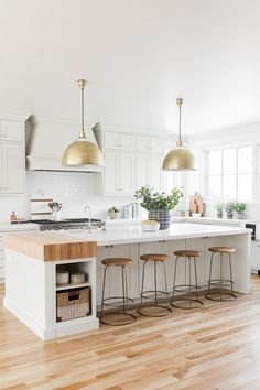 Warm, beautiful kitchen with soft white paint and warm putty cabinets, gold natural decor, kitchen styling inspiration, Kitchen pendants | Studio McGee Blog