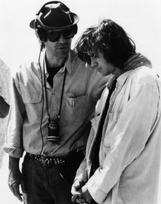 "Director Oliver Stone with actor Val Kilmer on the set of the 1991 film ""The Doors""."