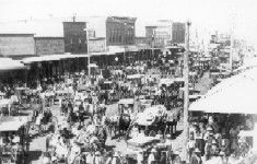 """""""A busy day on Chickasha Avenue"""" street scene of buggies and wagons crowding the streets. Western History Collections, University of Oklahoma Libraries, Irwin Brothers Studio Collection, Early Scenes"""