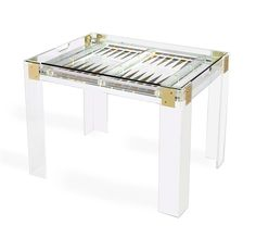 I am an avid backgammon player.  It is my favorite game and my children are learning this game of skill.  I have shown some of my favorite backgammon tables HERE.    I have a newly coveted favorite that I am ordering for myself to replace a sad game table that needs to find a new home.  Chic and fabulous, the Pierre Acrylic Backgammon Table evokes the jetsetter at play.