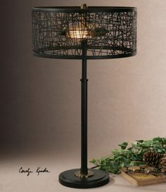 Rustic black metal base and a matching shade made of messed metal strips