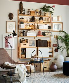 IKEA SVALNÄS shelving on a wall in a living room decorated with travel souvenirs. Svalnäs Ikea, Furniture Making, Living Room Furniture, Living Rooms, Rattan Armchair, Black Armchair, Ikea Family, Glass Cabinet Doors, Open Shelving