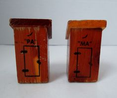 """This attractive set of outhouse salt and pepper shakers reads: """"MA"""" and """"PA"""" on the front and the side of the """"PA"""" outhouse reads Las Vegas, Nev. Both plastic stoppers are intact. Both plastic stopper"""