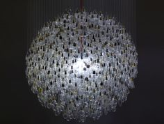 Tim Fishlock What Watt? What Watt? is a memorial to the incandescent light bulb. It's a spherical chandelier made up of 1243 suspended bulbs of various shape and size, illuminated by a single low-energy light source. Light Bulb Chandelier, Pendant Lighting, Unique Chandelier, Round Chandelier, Sisal, Modern Lighting, Lighting Design, Lighting Ideas, Deco Luminaire
