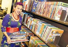 Mara Thacker of the University of Illinois with her collection of Indian comics. The university has about 1,500 Indian comics. (Jake Metz, The Media Commons Technical Support Specialist, University of Illinois)  #comics #india #Illinois #usa #library #indiancomics #art #collection #india
