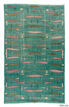 Turkish Vintage Rug around 50 years old and in very good condition. This mid-century modern inspired piece was designed by Zeki Muren who was a legendary singer in Turkey.