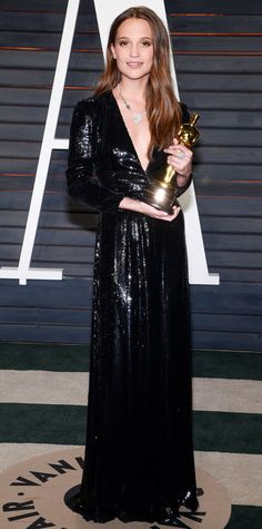 Alicia Vikander had a Disney princess moment on the 2016 Oscars red carpet, but she switched into something a touch sexier for the after-party, selecting a slinky sequined Louis Vuitton gown with a plunging neckline and long sleeves. A diamond pendant delivered the right dose of brilliance.