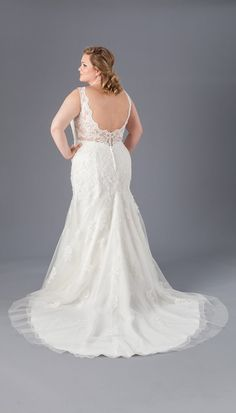 A Lace and Crepe Sheath Bridal Gown from Kennedy Blue | Affordable Bridal Gowns Under $1500 | Kennedy Blue  affordable, beautiful, wedding dresses, plus size, great quality, online, flattering, variety, wedding gowns