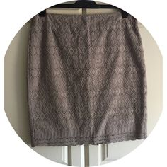 """ANN TAYLOR Taupe Eyelet Skirt Ann Taylor taupe eyelet skirt size 10P. I love the color of this skirt because you can wear almost any color top with it! It's a fun, feminine skirt! Hidden back zipper with hook and eye closure  Fully lined  Skirt and lining 100% cotton  20"""" long 16"""" waist measured flat. Ann Taylor Skirts Pencil"""