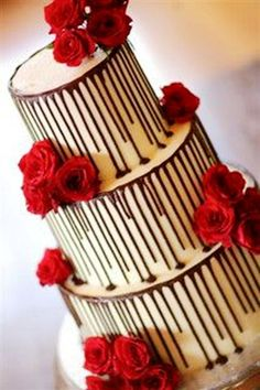 Valentine's day wedding decoration in 2014, Wicked chocolate wedding cake iced in white chocolate, decorated with fresh red roses #wedding  #decoration www.loveitsomuch.com