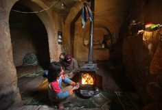Syrian family takes refuge in an ancient Roman tomb