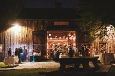 Barn wedding reception at night (photo: Michelle Gardella Photography)