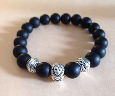 A personal favorite from my Etsy shop https://www.etsy.com/listing/219443207/mensunisex-matte-round-onyx-with