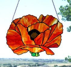 Red Poppy - Here is my version of Georgia O'Keefe's Red Poppy. I used Kokomo amber/red streaky glass. It measures about 15 inches wide and 11 inches high. I have always wanted to make this in glass! I have an Etsy shop: LadybugStainedGlass Stained Glass Supplies, Stained Glass Designs, Stained Glass Projects, Stained Glass Patterns, Mosaic Supplies, Stained Glass Flowers, Stained Glass Panels, Stained Glass Art, Mosaic Glass